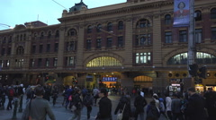 People rush to the train station at the end of a work day Stock Footage