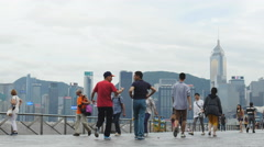 Tourists and commutors on Hong Kong promenade 4K Stock Footage
