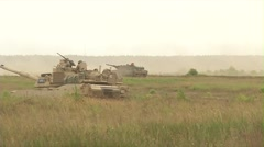 American Abrams Tanks and Danish Leopard Tanks live fire Stock Footage