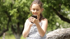 Kid playing on a smartphone Stock Footage
