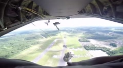US Air Force and Army work with Latvian soldiers for jump training Stock Footage