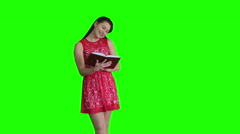 Woman in red dress with a book Stock Footage