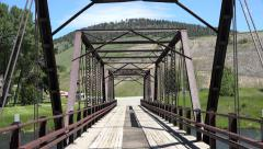 Drive POV historic Hutchins Bridge Madison River Montana 4K Stock Footage