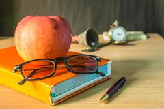 glasses and stationery on wooden - stock photo