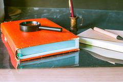 Old books and stationery - stock photo