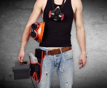 Worker with toolbelt and wrench Stock Photos