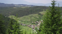 Alpine village in a beautiful valley with meadow Stock Footage