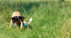 Young naturalist explorer with binoculars watching wildlife - stock footage