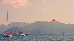 People with parachute above sea with yachts. Parasailing. Parachute with Turkish Stock Footage