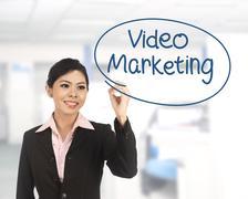 Asian business woman writing video marketing Stock Photos