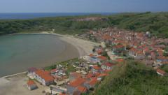 Aerial - Lower and upper village of Susak by the sandy bay Stock Footage