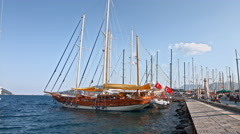 Splendid yachts at coast Aegean sea old pier in Marmaris. 4K raw video record Stock Footage
