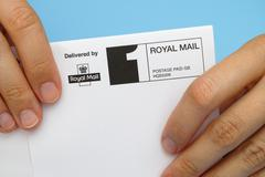 Envelope delivered by Royal Mail. - stock photo