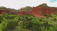 Lush Valley And Red Canyon Walls- Caprock Canyon State Park Stock Footage