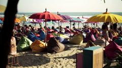 People on pouf sitting on beach in Bali  HD Stock Footage