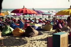 People on pouf sitting on beach in Bali  NTSC Stock Footage