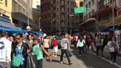 Stock Video Footage of Crowed of people in 25 of March area in Sao Paulo, Brazil.