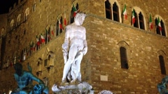 Statue in the evening on Palazzo Vecchio Florence Italy Stock Footage