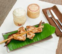 Roasting chicken with sticky rice - stock photo