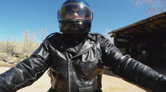 Low Angle Motorcycle Rider On Route 66 In Hackberry AZ Stock Footage
