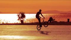 Stock Video Footage of Bike Acrobatics  at Sunset Time