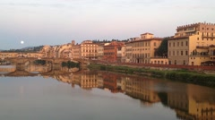 Ponte Vecchio during sunset set with the moon in Florence Italy Stock Footage