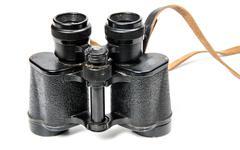 Old binoculars isolated - stock photo
