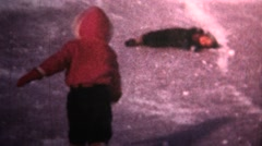 (8mm Vintage) 1966 Kids Winter Iceskating Fail Stock Footage