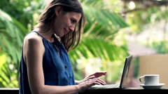 Young woman using laptop on terrace HD Stock Footage