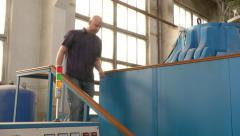 Man programing a cubic-presser at synthetic diamonds factory Stock Footage