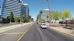 Driving In Phoenix Arizona Business District With Metro Rail Train - stock footage