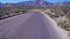 Fast Motion POV Motorcycle Rider In Red Rock Canyon- Las Vegas NV Stock Footage