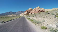 POV Motorcyclist Approaching Huge Boulders- Red Rock Canyon Stock Footage
