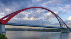 Beautiful sunset over the Bugrinsky Bridge over the Ob river in Novosibirsk Stock Footage