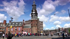 ULTRA HD 4k  Traffic street with people near Munttoren Tower in Amsterdam Stock Footage