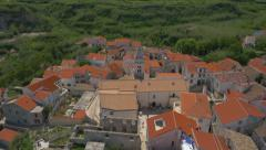 Aerial - High angle view of tourists visiting the Christian church on Susak Stock Footage