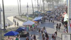 People biking, walking and performing on Venice Boardwalk - stock footage