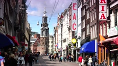 ULTRA HD 4k  Traffic street near Munttoren Tower in Amsterdam, zoom out Stock Footage