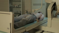 Radiological examination of the patient. Patient lying on scanner. Mri scan. Stock Footage