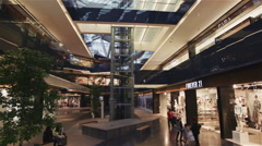 Big modern shopping mall from a climbing escalator Stock Footage