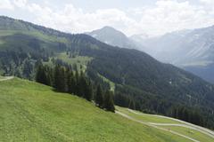 Summer over gree mountains of bregenz in austria Stock Photos
