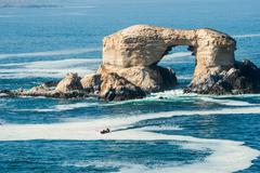 Stock Photo of Arch Rock Formation in La Portada National Reserve â?? rock-emblem coast of