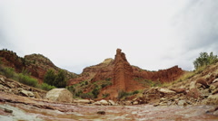 Small Creek Flowing In Front Of Rocky Peak- Caprock Canyon Stock Footage
