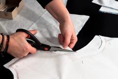 Woman hand cutting - stock photo