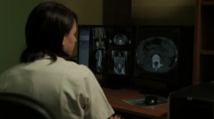 Radiological examination. Doctor looking at monitor and analyzing scanner image. Stock Footage