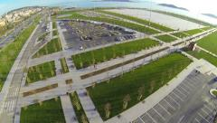 Car parking lots along recreational green park. Aerial view Stock Footage