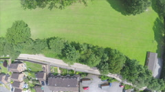 Aerial Birds-Eye-View Of English Park Overhead Field Trees Houses Drone Footage Stock Footage
