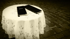 Old film footage: two black menus lying on the outdoor table of a cafe Stock Footage
