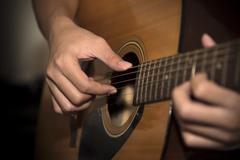 Still life man playing guitar Stock Photos