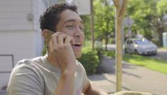 Attractive Young Man Answers His Smart Phone, Has Short Conversation, Hangs Up - stock footage
